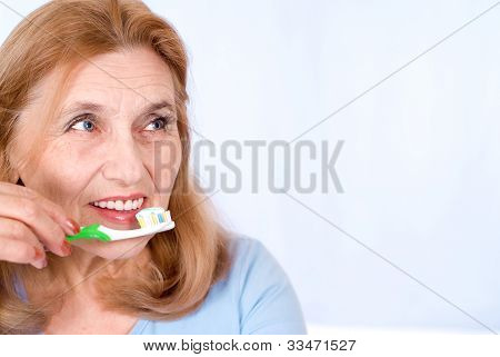 Old Woman Brushing Teeth