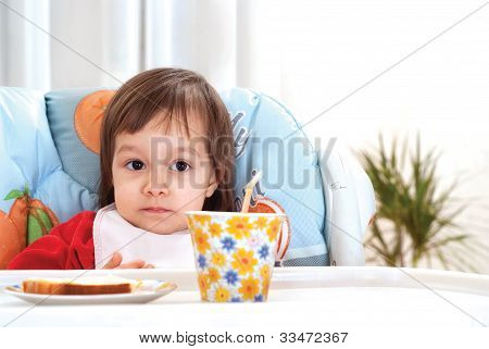 Little Girl At Breakfast