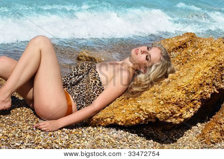 Sunbaths. Beautiful Woman Lying On The Beach. Bodycare