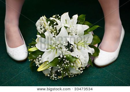 Bridal Bouquet And Bride's Feet