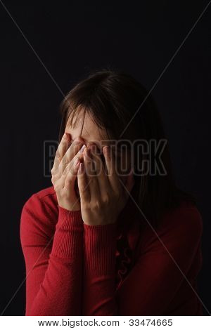 Beautiful Sad Caucasian Female In Red Sitting