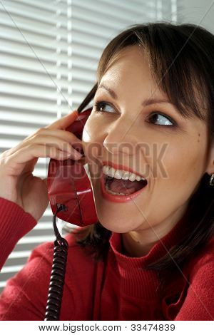 Beautiful Caucasian Smile Woman With A Phone