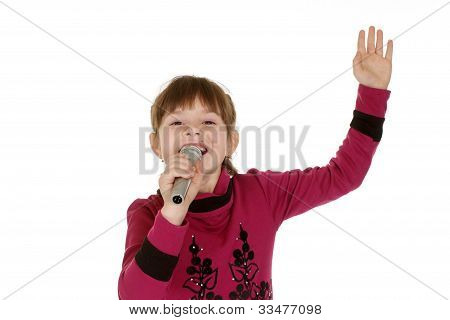 Little Girl Singing Into A Microphone