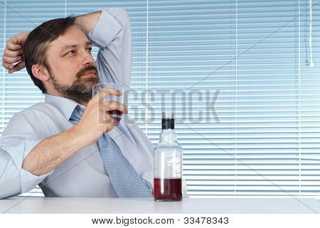 Business Sitting At A Table With A Bottle