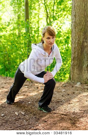 Attractive Young Woman Stretching Before Run