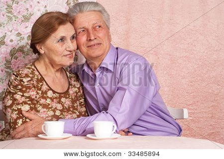 A Beautiful Pair Of Senior People Sitting Together
