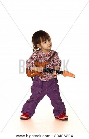 Beautiful Nice Little Caucasian Girl Plays With A Guitar