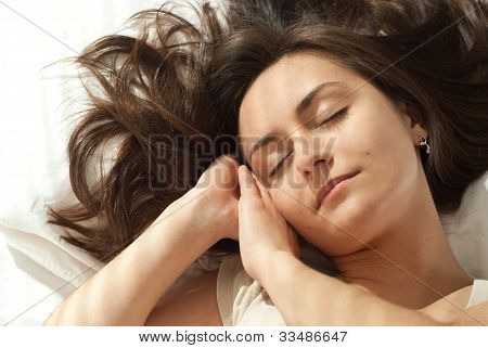 Young Caucasian Woman Asleep In Bed