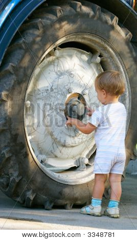 Little Boy Near Big Truck Wheel