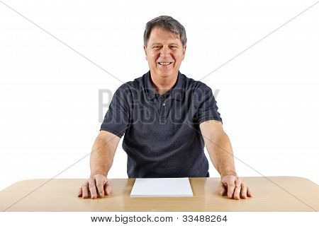 Casual Business Man Sitting At A Table