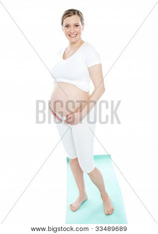 Pregnant Woman Touching Her Belly