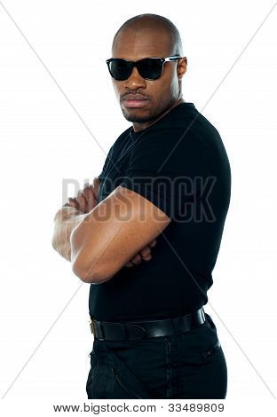 Portrait Of Secret Agent Standing With Hands Folded