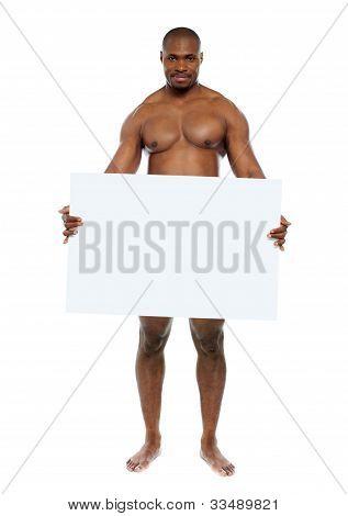 Naked Man Hiding Behind Blank White Billboard