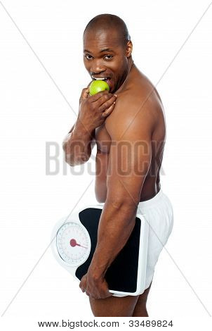 Young Man Enjoying Fresh Green Apple