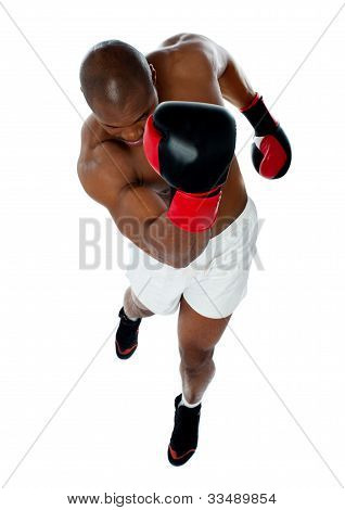 A Black African Athletic Boxer With Boxing Gloves