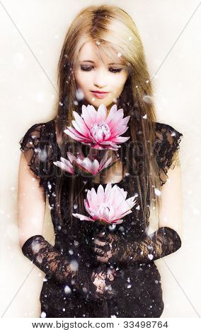 Beautiful Young Woman Holding A Delicate Flower