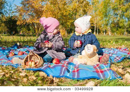 Two Little Girls On Walk In Park
