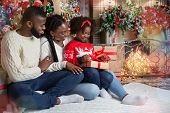 Family Christmas Concept. Cute Little Black Girl Opening Gift Box On Christmas Eve While Sitting On  poster