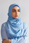 Beautiful Muslim Woman In Hijab Against White Background. Portrait Of Pretty Middle-eastern Female W poster