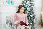 Christmas Surprise. Surprised Child Read Surprising Story On New Year. Small Girl Keep Mouth Opened  poster