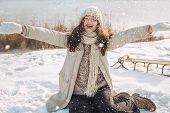 Winter Woman Playing In The Snow Throwing Snow Up In The Air Smiling Happy Having Fun Outside On Sun poster