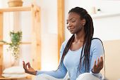 Meditation. Peaceful African American Woman Meditating Sitting In Lotus Yoga Pose In Bed Relaxing At poster