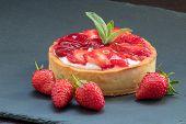 Delicious Homemade Strawberry Tart On Slate Plate. Tasty Fruit Dessert On Table. Yummy Tartlet Recip poster