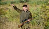 Look There. Noticed Game. Man Brutal Unshaved Gamekeeper Nature Background. Hunting Permit. Hunting  poster