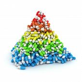 stock photo of triangular pyramids  - Medical pyramid made from multicolored layers of capsules - JPG