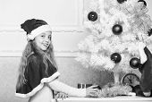 Child Decorating Christmas Tree With Red Balls Ornaments. Girl Kid Decorating Christmas Tree. Cheris poster
