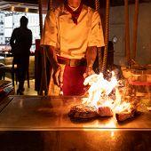 Cooking of beef teppanyaki recipe japanese grilled beef tomahawk steak on cooking pan using scraper  poster