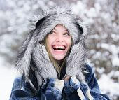 Cold Winter Weather. Beautiful Woman In Warm Coat, Fur Hat And Mittens. Fashion Girl In Wintertime.  poster