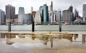 Panoramic View Of Manhattan Skyscrapers Shot From Brooklyn Bridge Park On A Rainy Summer Day. New Yo poster