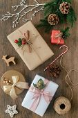 Christmas Wood Table Plank Decorate With Many Beautiful Gift Box, Pine Leaves And Pine Cones, Candy  poster