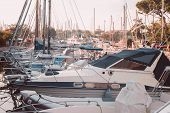 Yacht Club. Yachts Moored In The Port Against The Backdrop Of The Setting Sun. poster
