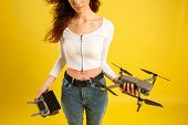 Teen Girl Launches Aerial Drone Quadcopter. Isolated On A Yellow Background. Aerial Photography. poster