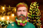 Decorated Beard. Serious Bearded Man With Decorated Beard. Christmas Beard Decorations. New Year Par poster