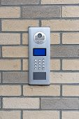 Safety In Modern Residential Buildings. Electronic Lock At The Entrance To A Residential Building. poster