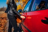 Opening Car Door. Woman Opens Red Car With Key On Autumn Road. Driver Ready To Go poster