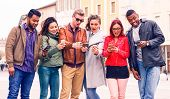 Multicultural Group Of Friends Looking  Phone With Surprised Face - Multiracial Teenagers Having Fun poster