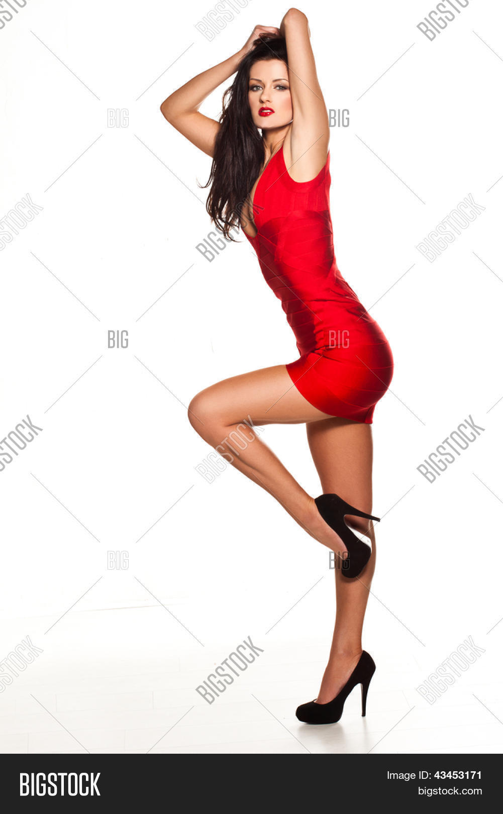 Beautiful sexy woman wearing red dress and black high heels shoes ...