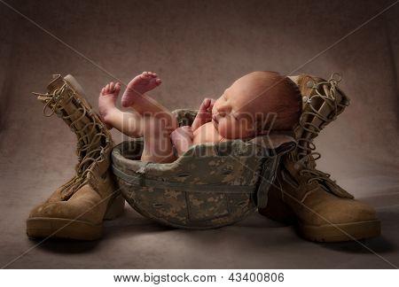 Newborn Baby in Helmet