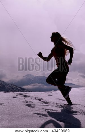Silhouette Of Woman Running In Snow