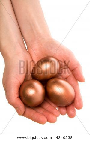Three Gold Eggs In Palm