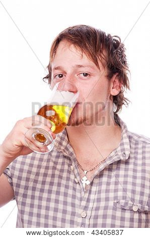 A young man drinking beer, isolated on white
