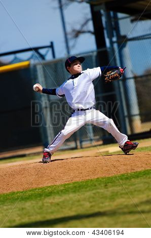 Little League Pitcher In White Jersey