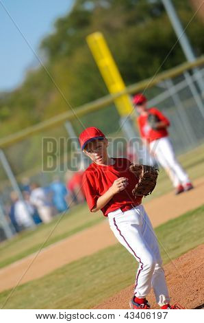 Little League Pitcher Looking At Third