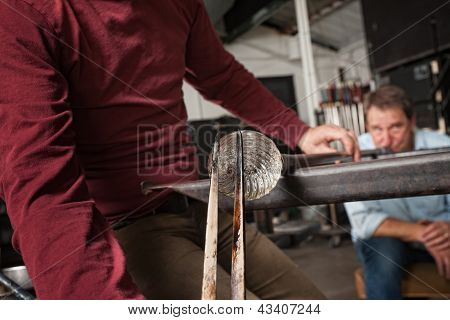 Men Creating Clear Glass Object