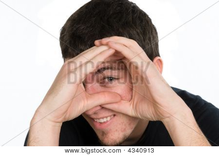 Man Peeking Through Hands