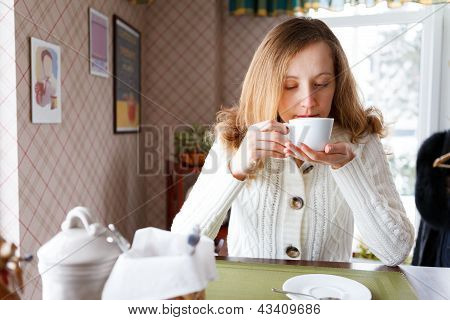 Young Woman Drinking Coffee. Cup Of Hot Aromatic Beverage